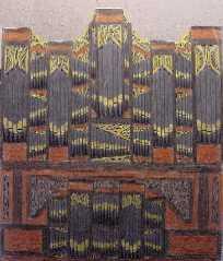 Orgel bruin met geel houtsnijwerk
